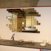 Portrait d'horizon est un miroir au design changeant grasse à ses lamelles de miroir amovibles.En vente chez Steiner à Rouen et